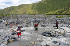 People crossing river  at island New Guinea Royalty Free Stock Photography