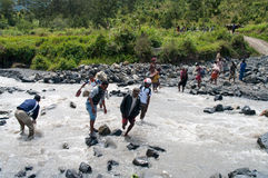 People crossing river  at island New Guinea Stock Images