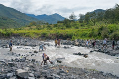 People crossing river  at island New Guinea Royalty Free Stock Photos