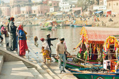 People crossing the river by riverboat of an old indian city Stock Images