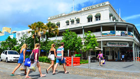 People crossing a road in Cairns Queensland Australia royalty free stock image