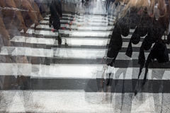 People crossing a road. Hurrying, blurred motion stock photography