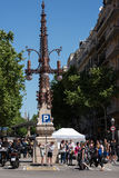People are crossing road near vintage street light at Barcelona town Stock Photos