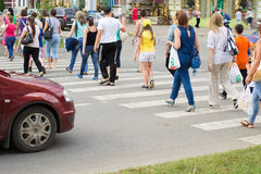 People crossing the road. At a pedestrian crossing Royalty Free Stock Image