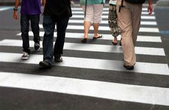 People crossing road during rush hour Royalty Free Stock Photos