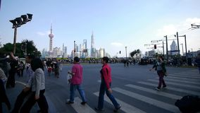 People crossing the road with Shanghai lujiazui business building background. stock video