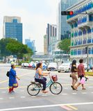 People crossing a road. Singapore Royalty Free Stock Image