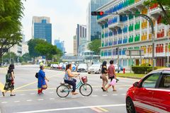 People crossing a road. Singapore Royalty Free Stock Images