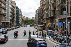 People are crossing road at street of Barcelona town, Spain Stock Photo