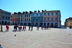 People crossing the square, street life Royalty Free Stock Image