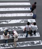 People crossing the street. Upper view with motion blur aspect Royalty Free Stock Photography
