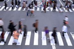 People crossing the street. Motion blur aspect of people crossing the street in a big city Royalty Free Stock Photos