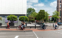 People crossing the street by bicycle Stock Photo