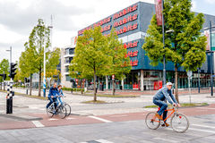 People crossing the street by bicycle Royalty Free Stock Photo