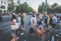 People crossing street , blur / city traffic Royalty Free Stock Images