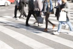 People crossing a street royalty free stock photo
