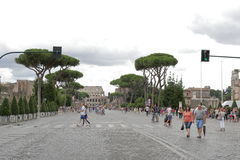 People crossing street by crosswalk in Rome, Italy Stock Photography