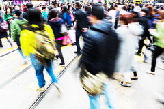 People crossing a street in Hong Kong with motion blur Stock Photo