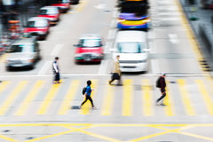 People crossing a street in Hongkong Royalty Free Stock Image