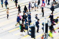 People crossing a street in Hongkong Stock Images