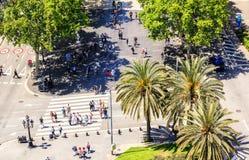 People crossing the street. La Rambla de Santa Monica, Barcelona Stock Photo