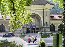 People crossing the street near Sinaia Royal Station Stock Image