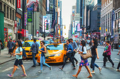 People crossing a street in New York. NEW YORK CITY - SEPTEMBER 4: People crossing a street on September 4, 2015 in New York Royalty Free Stock Image