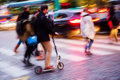 People crossing a street at night Royalty Free Stock Image