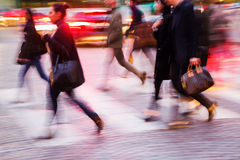 People crossing a street at night Stock Photography