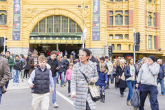 People crossing the street outside the Flinders Street Station in Melbourne. Melbourne, Australia - August 29, 2015: View of people crossing the street outside Stock Photography