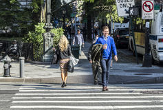 People crossing a street at a pedestrian crossing in New York Royalty Free Stock Image