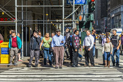 People crossing a street at a pedestrian crossing in New York Royalty Free Stock Images