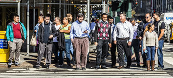 People crossing a street at a pedestrian crossing in New York Stock Photos