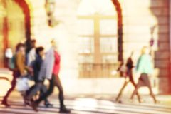 People crossing a street stock illustration