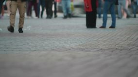 People crossing street time-lapse, close up of feet. people moving in crowded city street. Art toning abstract urban