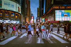 People Crossing the Street at the Times Square in New York City Stock Photo