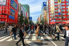People crossing the street at Tokyo's Akihabara area Royalty Free Stock Image