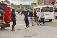 People crossing the street at Ulas. Davao, Philippines - January 19, 2018: People crossing the street at Ulas, third distric part of the City. Traffic is also Royalty Free Stock Photography