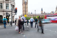People crossing a street in Westminster, London Stock Image