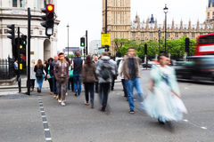 People crossing a street in Westminster, London Stock Photos