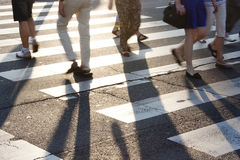 People crossing the street at zebra crossroad in summer Stock Photo