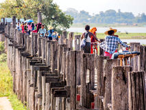 People crossing U-Bein bridge, Mandalay, Myanmar 1 Royalty Free Stock Image
