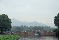People are crossing the west lake in Hangzhou by bridge Royalty Free Stock Photo