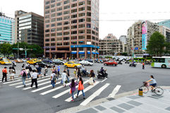 People crossing the Xinyi District, Taipei Stock Photos