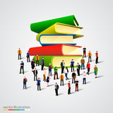 People crowd around book stack Stock Image