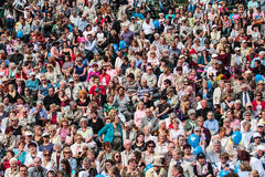 People crowd. Big crowd of people sitting during the concert Royalty Free Stock Photos