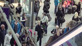 People crowd on the railway station terminal. Berlin, Germany - October, 9, 2016: People crowd on railway station terminal in Berlin, Germany. Commute train stock video footage