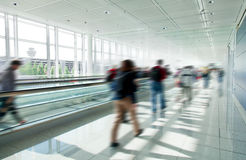 People crowd in rush at airport Stock Photos