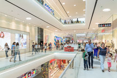 People Crowd Rush In Shopping Luxury Mall Interior. BUCHAREST, ROMANIA - JULY 06, 2015: People Crowd Rush In Shopping Luxury Mall Interior Stock Images