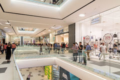 People Crowd Rush In Shopping Luxury Mall Interior Stock Photos
